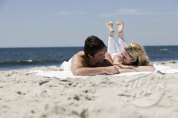 Couple relaxing at a beach.